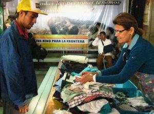 Volunteer Lourdes Monroy distributes clothing at the comedor.