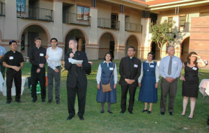The KBI staff and volunteers gather as Fr. Sean welcomes the dinner guests.