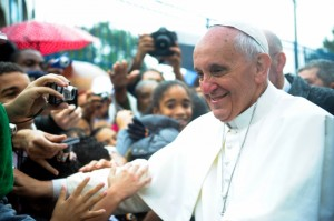Pope Francis, welcomed by a crowd in Vargihna, Brazil, July 2013. Public domain image from Wiki Commons, photo by Tânia Rêgo.