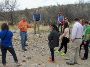 "West Cosgrove, KBI Director of Education, leads KBI visitors on a desert hike, a way to ""walk in the migrants' footsteps."" Photo by Marilynn Lorenz."
