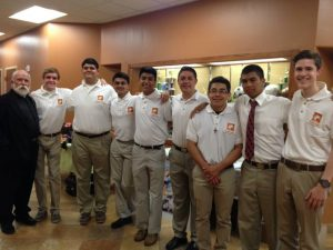 Brophy Kino Teens line up with Father Pete Neeley at the Fourth Annual KBI Dinner in Phoenix. Photo by Johnny Lazoya.
