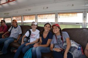 On a KBI Immersion: Students from St. Ignatius College Prepatory in San Francisco ride the bus in Nogales, Sonora, the border fence behind them. Photo by Dave Tognotti.