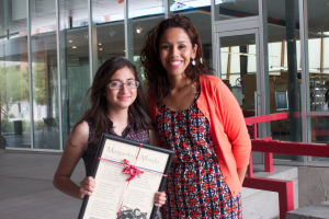 At the Poetry Center's Award Ceremony: Daniela Ibarra, with her Amphitheater High School AP Spanish teacher Alma Mejía, shows off a framed copy of her prize-winning corrido. Photo by Vanessa Alvarez.