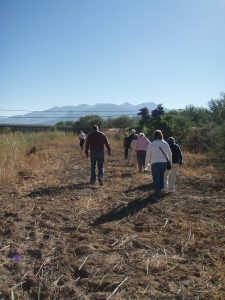 KBI visitors walk the path of the migrants. Photo by Tricia Lothschutz.