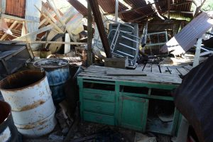 The abandoned debris of former residents is piled high to make room for waiting and sleeping.