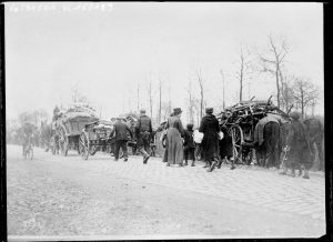 French and Belgian refugees fleeing Paris, April 1918.  Public domain image from the Bibliothèque Nationale de France.
