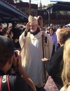 Cardinal Seán O'Malley blesses the crowd at the border.