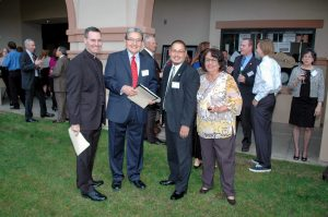 At the pre-dinner reception, Father Sean with Frank Camacho, Maricopa County Supervisor Steve Gallardo, and KBI board member Dora Vasquez.