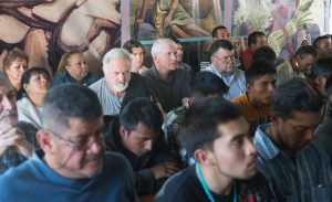 The Jesuit Provincials and the migrants attend Mass at the comedor.