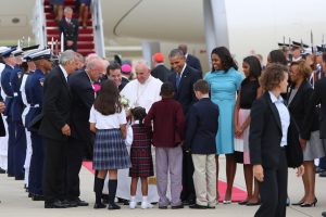 Pope Francis, with President Obama and the First Family, greets well-wishers at Andrew Air Force Base. September 23, 2015. Photo by Marcus Bleech/Jesuit Conference of Canada and the United States.