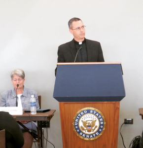 At a September 2015 congressional staff briefing, Father Sean shares the results of the recent study from the KBI and the Jesuit Conference of Canada and the U.S. Photo from Ignatian Solidarity Network.