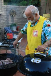 Fr. Pete Neeley was in charge of the grill. Photo by Hung Nguyen, S.J.