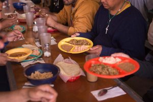 Plates are passed along each table. Photo by Larry Hanelin.