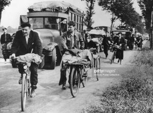 Refugees leaving Paris after the fall of France, circa June 1940, the same month that Walter Benjamin fled to Spain. Photo by Anthony Potter Collection/Hutton Archive/Getty Images.