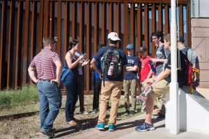 At the border fence, Joanna talks to the students about the migrant experience.