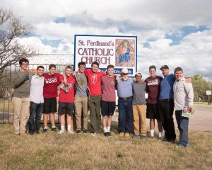 Altogether outside St. Ferdinand's in Arivaca, where the students attended a Mass celebrated by Father Peter Neeley, S.J. (fifth from the right).