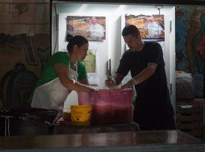 KBI staff member Mariana Serrano Reyes and a visiting student take on the dishwashing duties.