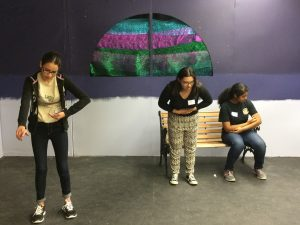 In the theater workshop, participants explore the migrant experience through improvised scenes.