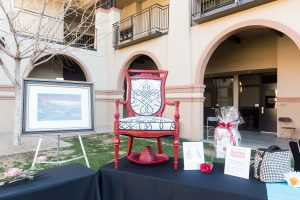 Among the appealing silent auction prizes was a custom-painted and upholstered chair created by Kathy Desmond and her daughter Megan.