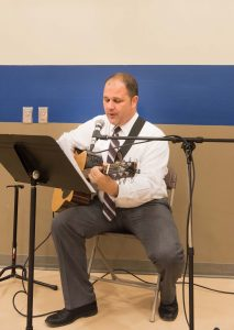 Paul Fisko, a Brophy faculty member, serenades the dinner guests on their way in with a Spanish rendition of the Suscipe, a Jesuit prayer written by St. Ignatius of Loyola.
