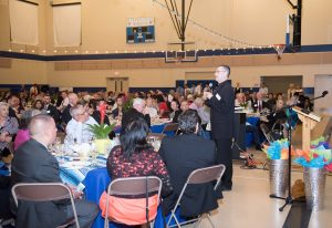 Father Sean addresses the sold-out hall.