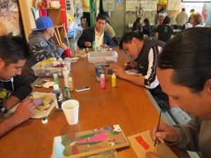 Migrant painters create works they can sell to help support themselves during an uncertain time.