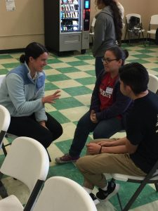 Joanna preps the student assistants at the Walking in Mercy Youth Summit in February.
