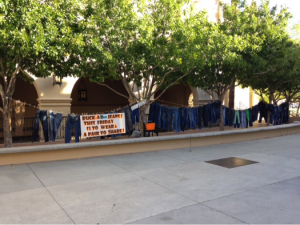 """A creative way to spur donations: The students of Brophy College Preparatory in Phoenix wore jeans on Halloween and brought pairs to donate to the KBI for their """"Boo Jean"""" campaign. Photo from Brophy College Preparatory."""