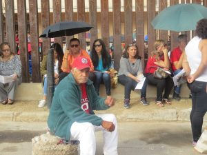 People gather on the U.S. side of the border fence for a bi-national Mass celebrated in Ambos Nogales.