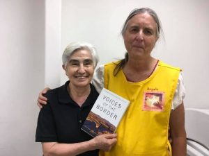 Sr. Engracia with Tobin holding their new book.